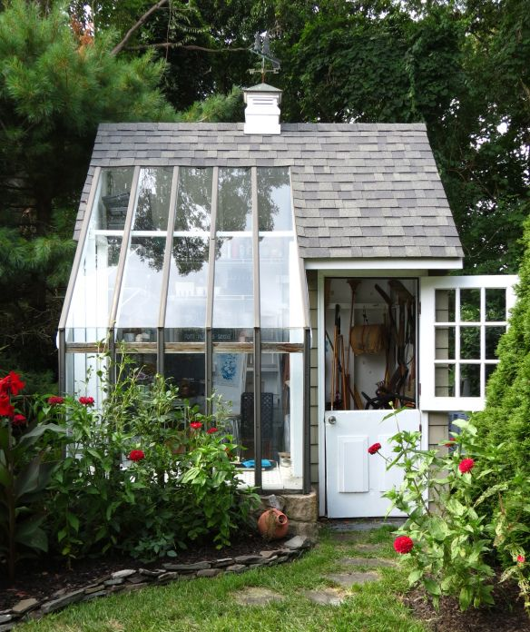 Brilliant idea, garden workroom with half a glass roof.
