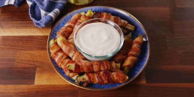 Bacon Pickle Fries... 12 Pickle Spears, 12 strips Bacon, 1/4 c. Ranch Dressing... Preheat 425°. Wrap each pickle spear in bacon. Place bacon-wrapped pickles seam side-down on baking sheet. Bake 12-15 min until cooked through and crispy, turning halfway if needed. Serve warm or room temp with Ranch dressing for dipping (opt).