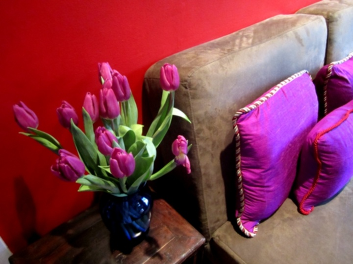 red wall and diy silk purple pillows