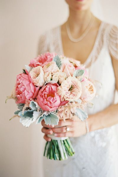 Spring bouquet of peach garden roses, coral peonies, pink astilbe, dusty miller, and spray roses