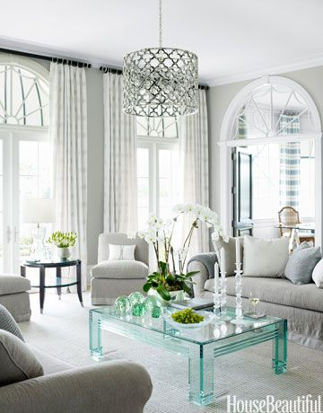 BRIGHT LIVING ROOM DECOR MADE OF GLASS AND NEUTRAL COLORS | Lucite-and-glass table provides a jewel-like accent to the muted tones of the living room | www.bocadolobo.com #livingroomdecor #interiordesign