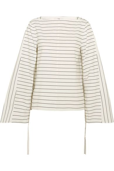 Tibi's top is one of the label's key silhouettes this season – defined by its elegant boat neckline and Edwardian-inspired oversized sleeves. It's cut from crisp cotton-poplin and woven with utilitarian pinstripes. Pull the drawstring ties at the cuffs to create a chic ruched effect through the arms.