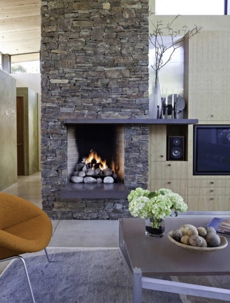 Gorgeous stone fireplace in a modern #California residence...does CA ever get cold enough to use it though?