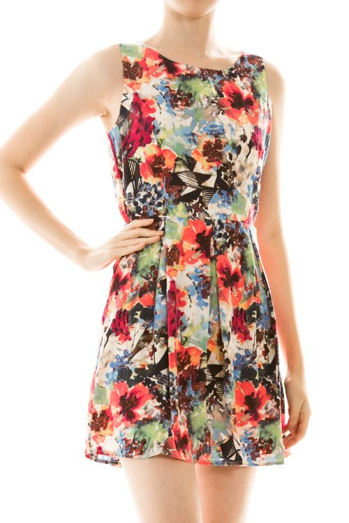 This abstract floral print dress is truly a masterpiece. Hints of blues, oranges and pinks make it easy to match with the perfect shoe or throw a cardigan over top while the weather is still too cool to go sleeveless.