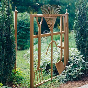 Better Homes and Gardens has garden gate ideas like this one. We'd need to add a few more rakes, facing down and even truncated to fill in the small gaps that the deer seem to push through.