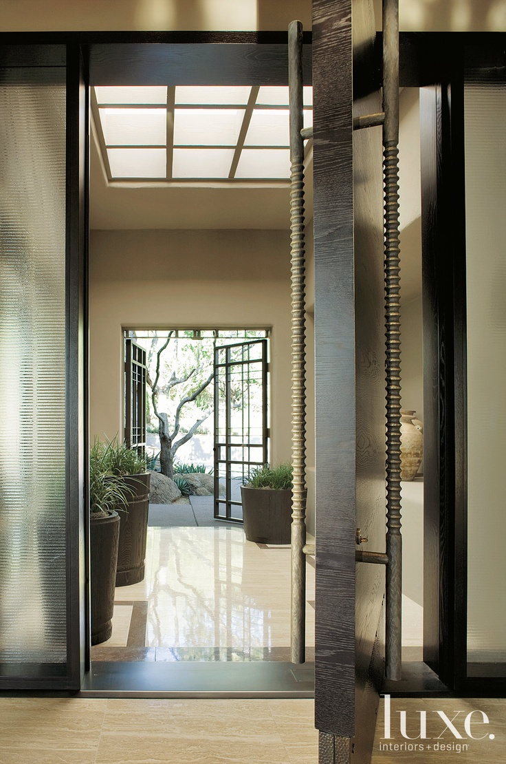 A Steel and Glass Entry - Luxe Interiors + Design