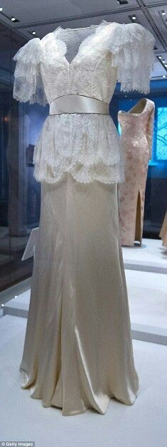 A white lace Bruce Oldfield dress, right, as worn by Princess Diana will feature in the fashion display: