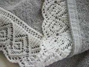 Pleasingly reversible lace edging attached to hem of towel