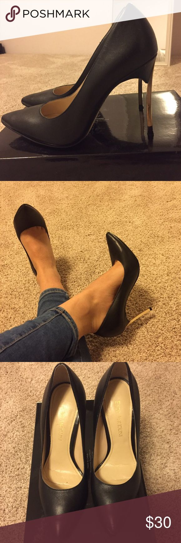 Enzo Angiolini black stiletto pumps w/ gold heels Enzo Angiolini black stiletto pumps with gold heels. Size 5.5. Worn a few times but in near perfect condition except for a nick on the gold heel of one of the pumps (as seen in the photo). Enzo Angiolini Shoes Heels