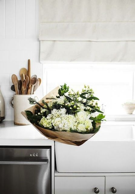 all white flowers from the market and an assortment of wood spoons - dreamy