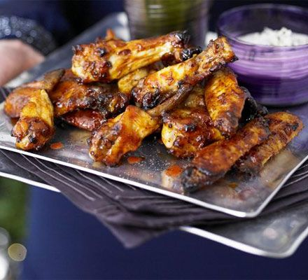 Baked buffalo chicken wings. Sticky spiced wings make great finger food or canapés, and this version skips the deep-fried stage so they're healthier.