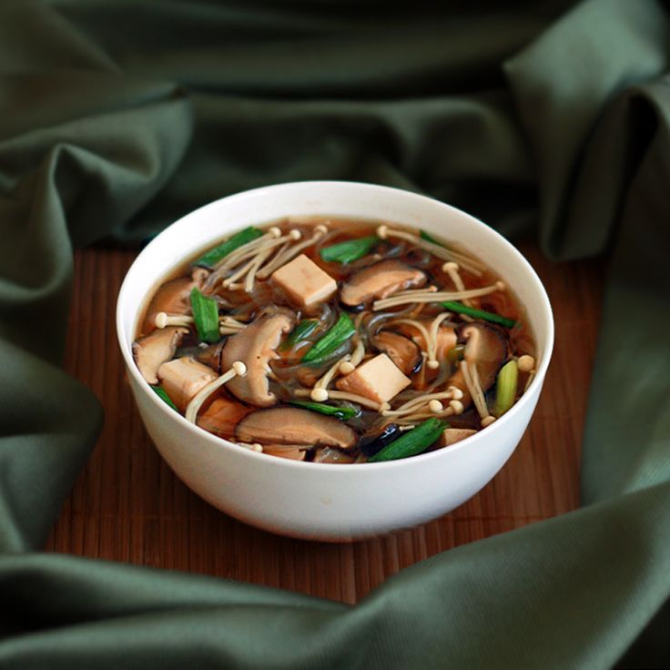 Japanese Mushroom, Tofu and Vermicelli Soup.    Shiitake and enoki mushrooms grace a delicious mirin-sake infused broth.  Low cal, low carb, low fat, but FULL of flavor!