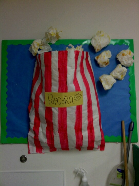 3d board For circus theme. Splatter paint paper with yellow, then crinkle up for popcorns