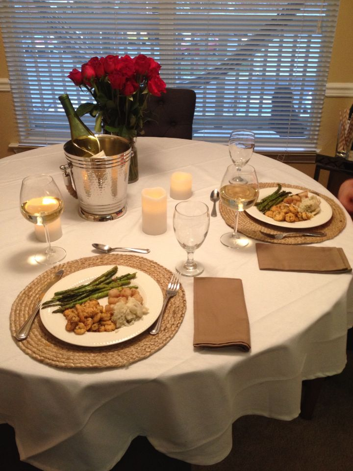 Romantic dinner for him!   Seared scallops, shrimp and asparagus.  Flowers, candles and white wine... Perfect date night in!