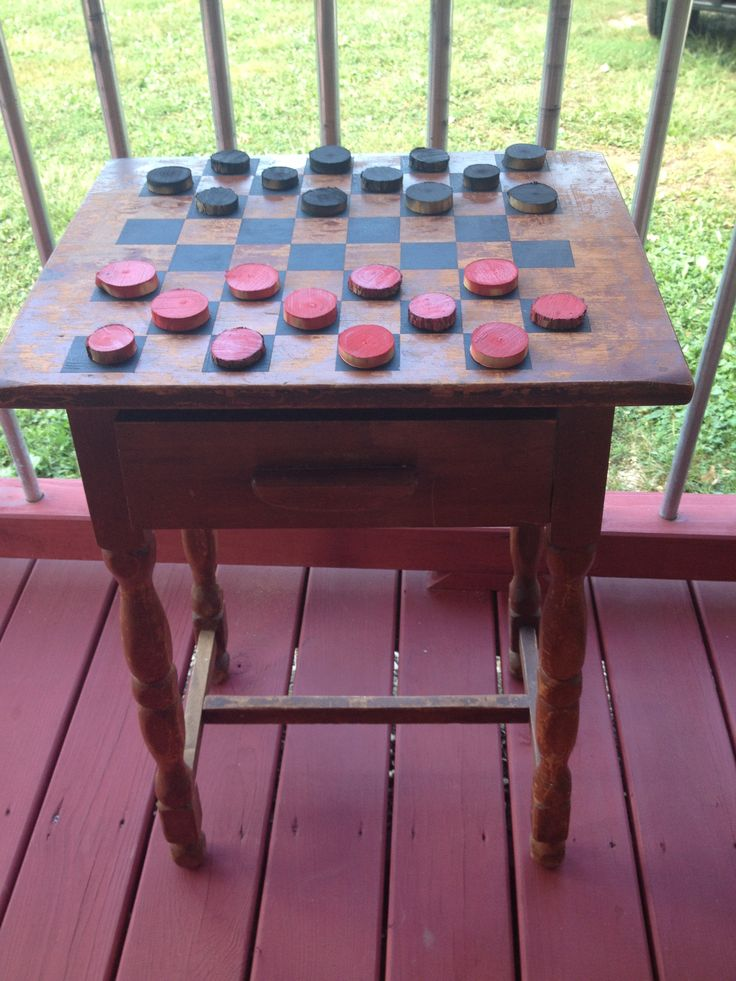 Outdoor checker table made from an old distressed end table.  Checker pieces made from a limb!!