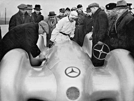 Rudolf Caracciola getting in to the Mercedes-Benz W154 12-cylinder record car, for a record-breaking attempt in Dessau, 1939.