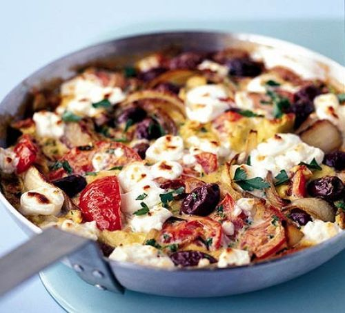 Greek salad omelette - enjoy all the flavors of Greece with red onion, tomato, black olives and feta cheese in this omelette.