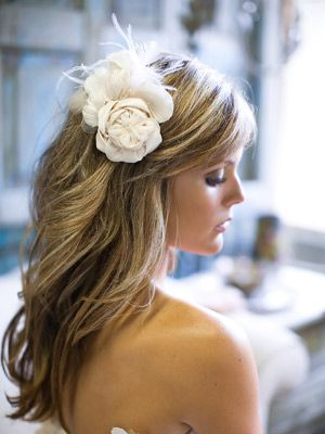 Romantic Waves with Comb To dress up her loose spiral wave, Jennifer used a flower brooch made from fabric flowers that had been on her dress.