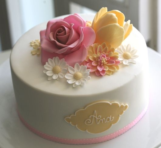 pink and yellow flower cake