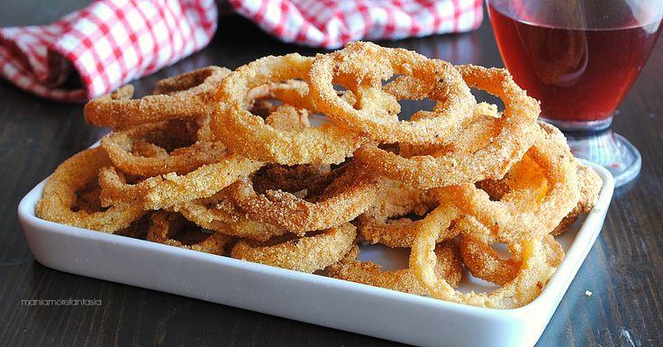 Gli anelli di cipolla fritti sono buonissimi! Non ci sonoaltri aggettivi per questi sfizi golosissimi! Meglio delle patatine, uno tira l'altro!