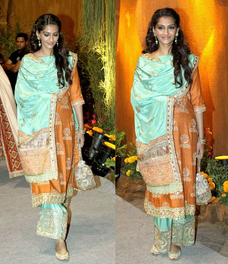 Sonam Kapoor in an ethnic overdrive - dressed in classic Punjabi attire: a shimmering bronze and blue salwar suit