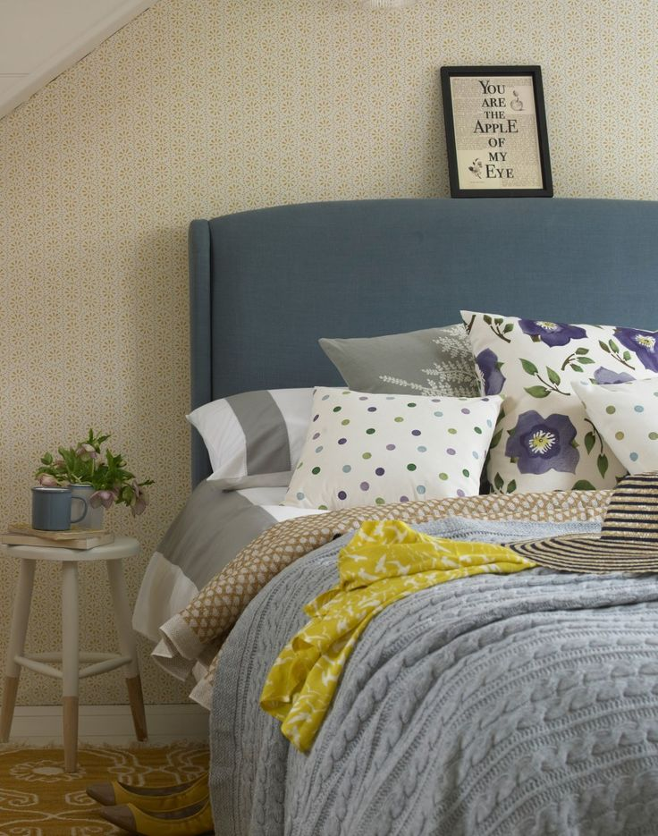 Country Bedroom with Retro Print Wallpaper and Carpet