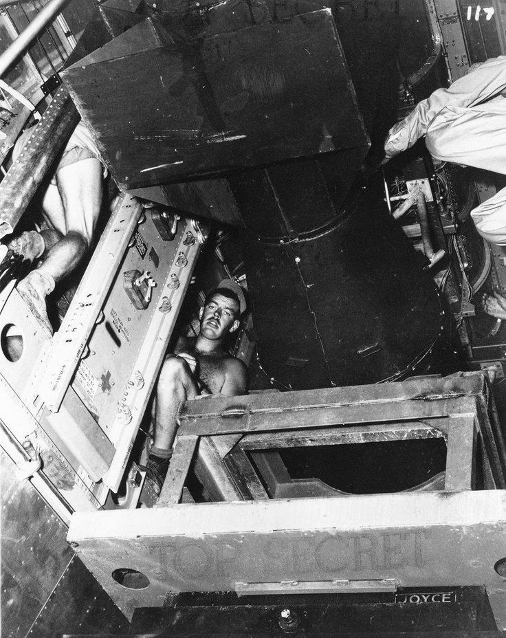 """""""Little Boy"""" atomic bomb is being loaded into the bomb bay of B-29 """"Enola Gay"""", North Field, Tinian Island, 06 AUG 1945 [900 x 1135]"""