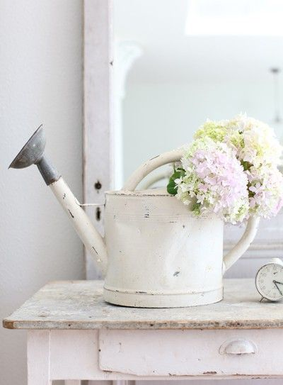 white watering can with flowers ~