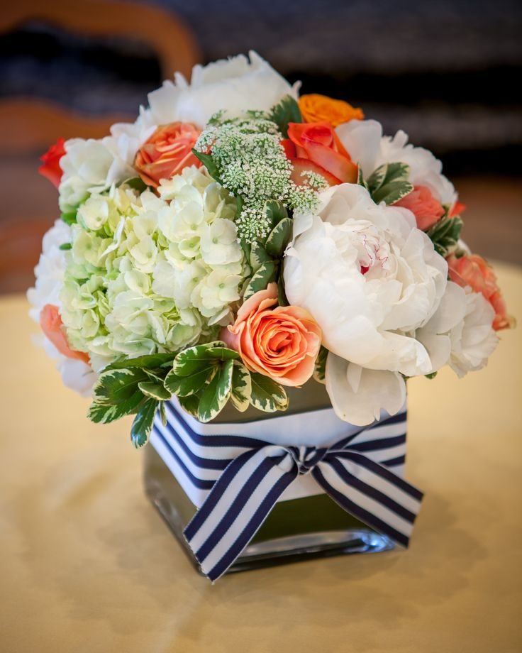 Coral and white centerpiece with a touch of navy blue i
