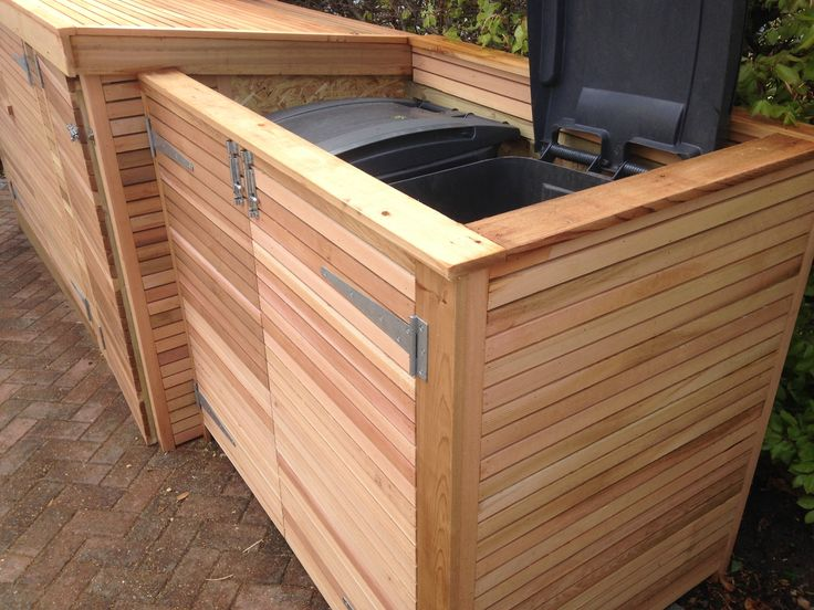 Bike shed with bin store attached. Clad in horizontal cedar slats