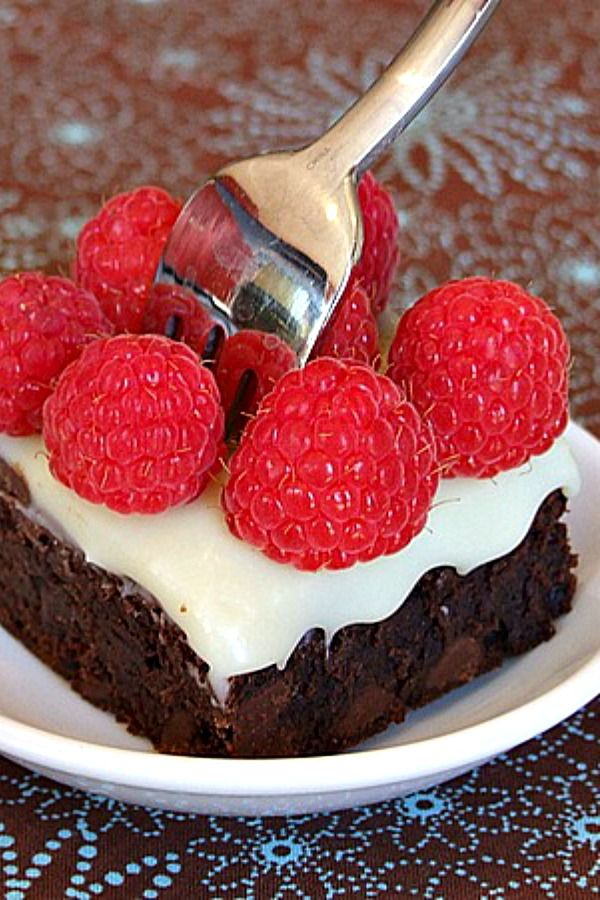 Quintuple Chocolate Brownies : These qualify as INSANE brownies!! Very fudgy and delicious. I'm not even a big fan of white chocolate, but the white choc. ganache makes a great topping. Raspberries are completely optional, but they do look very pretty!