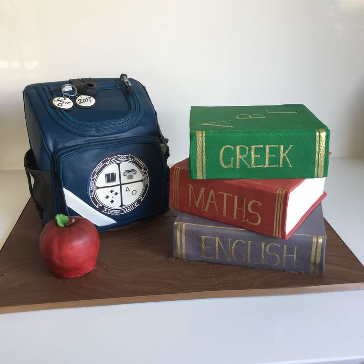 Year 6 graduation cake. Replica of school bag with logo and stack of books.