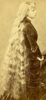 Blonde Victorian girl with very, long hair.