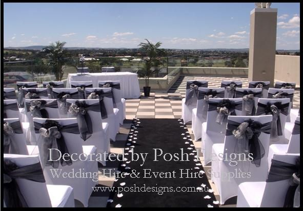 Black organza sashes, white lycra chair covers, black aisle carpet all for hire for your outdoor ceremony. Australia wide. Visit www.poshdesigns.com.au for more photos and info, or email lisa@poshdesigns.com.au for pricing packages.