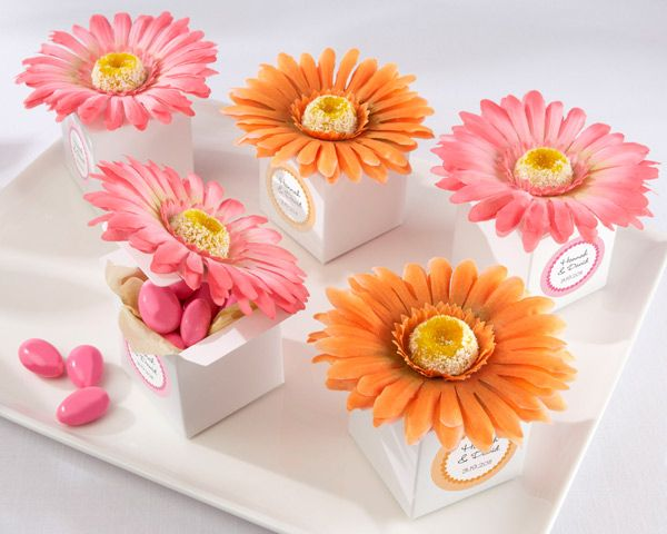 These pretty Gerbera Daisys would fit in with the flower theme, but I don't know if it would be too much on the tables ????