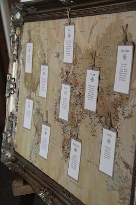 Vintage travel themed seat chart display with an old world map