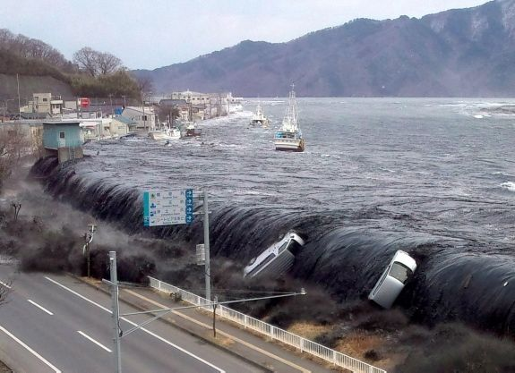 The earthquake triggered-tsunami waves, that reached heights of over 100 feet, engulf the Japanese coast. March, 2011