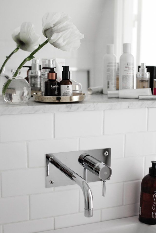 How chic is this faucet that comes directly out of the wall?! It seems as if this might be easier to keep clean as well.