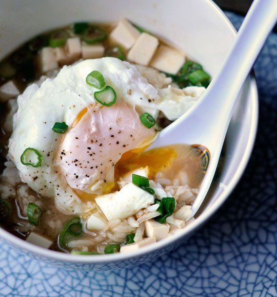 Miso Soup with Rice & Poached Egg by thekitchn: Salty, savory miso soup, fragrant with scallions, and poured over a bowl of rice and a poached egg. This, for me, is comfort food at its finest. Here's how to make this simple supper tonight. #Soup #MIso #Egg #Easy