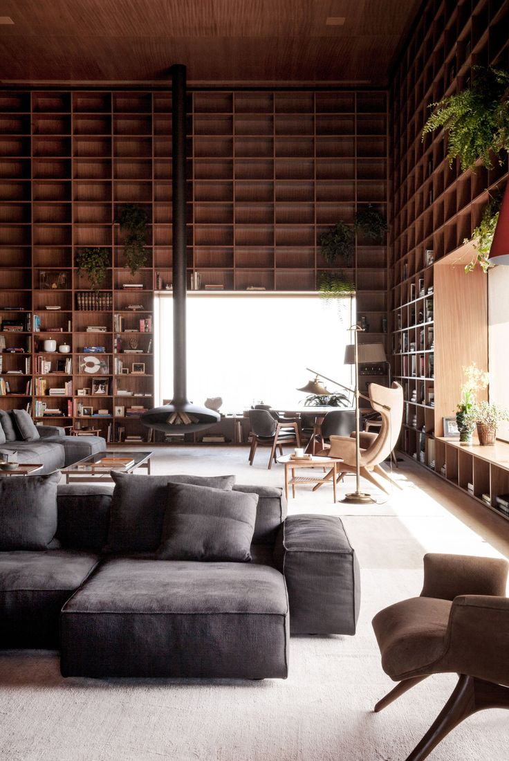São Paulo penthouse with giant double-height wooden shelves | designed by Studio MK27