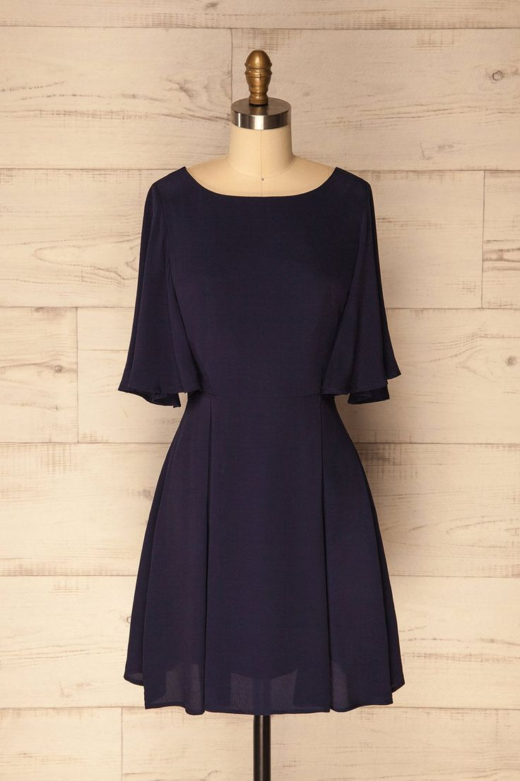 Velina Navy / This little navy dress is perfect for a back to school look that is sure to get noticed. The A-line skirt with box pleats falls perfectly to the knees for a sophisticated and modern look. The butterfly sleeves add a touch of fantasy to the classic cut while the nylon lining lets you feel comfortable all day long. This beautiful staple piece is an 1861 exclusive and we recommend acting fast-before our employees buy them all! #Boutique1861