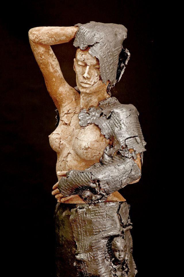 Clay plus random found scraps, sculpture by Polish artist Marek Zyga via artodyssey