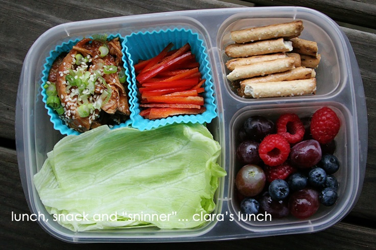 Leftover Crock Pot Sesame Honey Chicken, thin strips of red pepper and lettuce leaves to wrap it all up in, fruit (grapes, raspberries and blueberries) and a few Trader Joe's Honey Wheat Pretzels.  All packed up in an EasyLunchbox....For more ideas for school lunches visit http://school-lunch-ideas.net