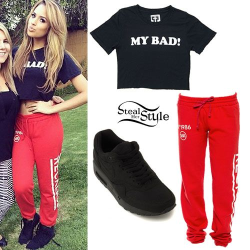 Jasmine V wearing a Petals and Peacocks My Bad Crop Tee ($34.00), Young & Reckless Untouched Red Fleece Sweatpants ($49.50), and all-black Nikes similar to the Air Max 1 Essential Sneakers ($100.00).