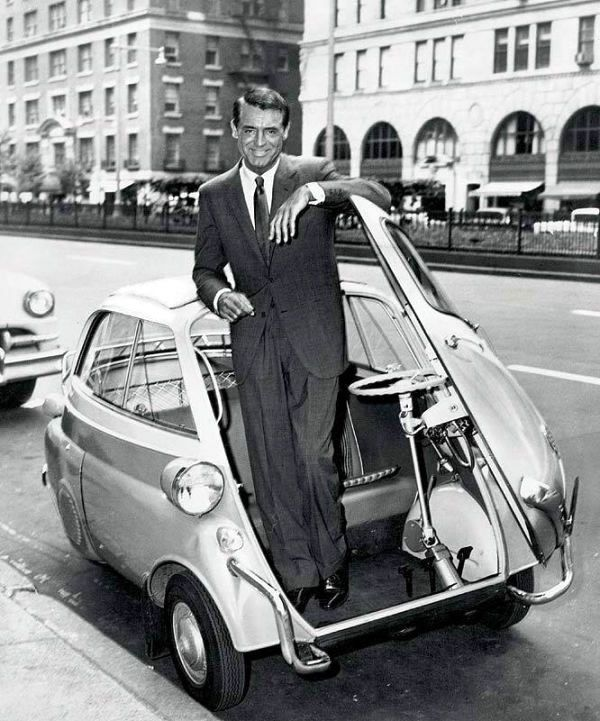 The utterly enigmatic Cary Grant exiting what looks like the very first SmartCar - NYC