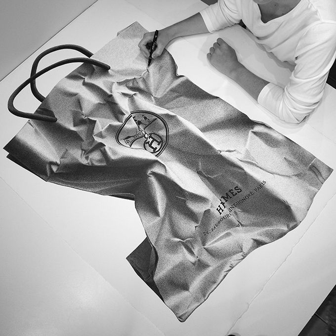 We discovered Australian artist CJ Hendry through her Instagram account and were immediately blown away by her work. Armed with only paper and pen, she creates magnificent, photorealistic black-and-white images in large format. Her subjects are generally high-end fashion objects, such as a Hermes scarf or a Louis Vuitton horse head, but they can also …
