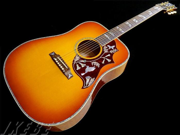 "Gibson Hummingbird Custom (2012) : Custom colour ""Tequila Sunrise"". Master grade quilted maple back & sides"