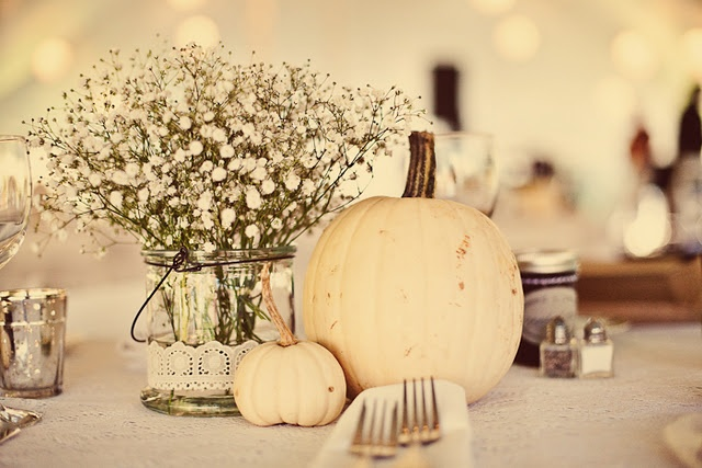 I've been considering using white pumpkins as center piece decor. This is really pretty..I'd use different flowers.