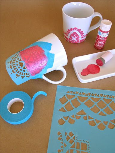 Stencilling on the mugs...use a foam pouncer to apply pearl paint over the taped-on stencil.