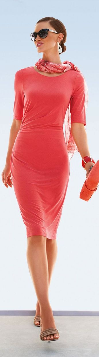 Slimming coral dress with fitting printed scarf and low bun